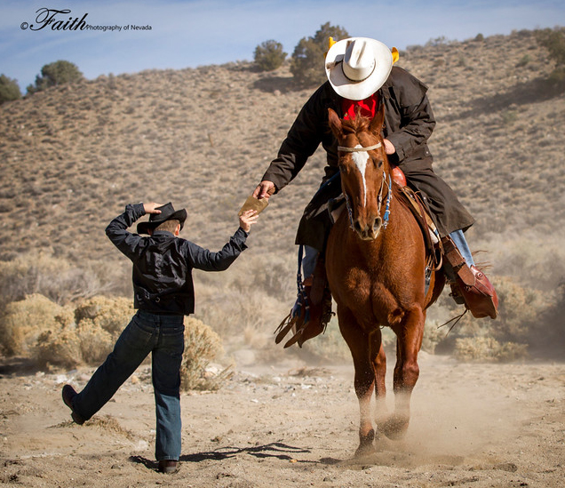 Pony Express Rider getting a donation from a young boy.